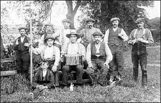 George Wilson, standing second from right, with his farm hands